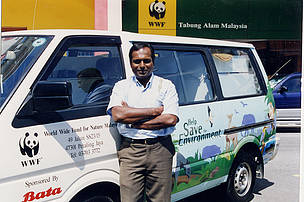Lasal Asirvatham, Youth Outreach Champion posing with Bata-sponsered WWF-Malaysia van.